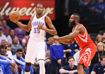 Nov 28, 2012; Oklahoma City, OK, USA; Oklahoma City Thunder small forward Kevin Durant (35) looks to pass on Houston Rockets shooting guard James Harden (13) during the game at Chesapeake Energy Arena. Oklahoma City won 120-98. Mandatory Credit: Kevin Jai