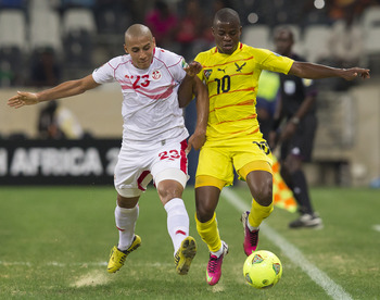 Wahbi Khazri (left) battles for the ball at the African Cup of Nations