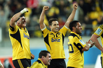 WELLINGTON, NEW ZEALAND - JULY 13:  L to R, Jeffery Toomaga-Allen, Ben May, Tim Bateman and Frae Wilson of the Hurricanes celebrate the win during the Super Rugby round 18 game between the Hurricanes and the Chiefs at Westpac Stadium on July 13, 2012 in W