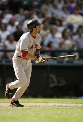 SEATTLE - JULY 20:  Nomar Garciaparra #5 of the Boston Red Sox runs toward first base as he watches the ball take flight during the game against the Seattle Mariners on July 20, 2004 at Safeco Field in Seattle, Washington.  The Red Sox defeated the Marine