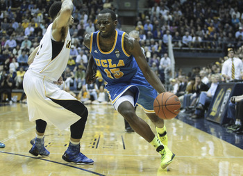 Feb 14, 2013; Berkeley, CA, USA; UCLA Bruins guard/forward Shabazz Muhammad (15) drives in against California Golden Bears guard Justin Cobbs (1) during the second half at Haas Pavilion. The California Golden Bears defeated the UCLA Bruins 76-63. Mandator