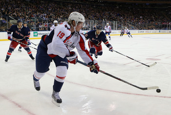 NEW YORK, NY - FEBRUARY 17: Nicklas Backstrom #19 of the Washington Capitals carries the puck against the New York Rangers at Madison Square Garden on February 17, 2013 in New York City. The Rangers defeated the Capitals 2-1.  (Photo by Bruce Bennett/Gett