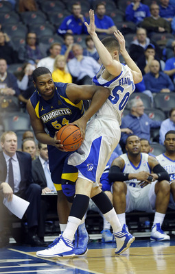 Feb 19, 2013; Newark, NJ, USA;  Marquette Golden Eagles forward Davante Gardner (54) gets caught in the corner by Seton Hall Pirates center Aaron Geramipoor (50) at the Prudential Center. Mandatory Credit: Jim O'Connor-USA TODAY Sports