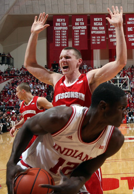 Jan 15 2013, Indianapolis, USA; Indiana Hoosiers forward Hanner Mosquera-Perea (12) grabs a rebound against Wisconsin Badgers forward Jared Berggren (40) at Assembly Hall. Wisconsin defeats Indiana 64-59. Mandatory Credit: Brian Spurlock-USA TODAY Sports