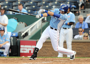 July 8, 2012; Kansas City, MO, USA; USA outfielder Christian Yelich hits a single during the sixth inning of the 2012 All Star Futures Game at Kauffman Stadium.  Mandatory Credit: Denny Medley-USA TODAY Sports