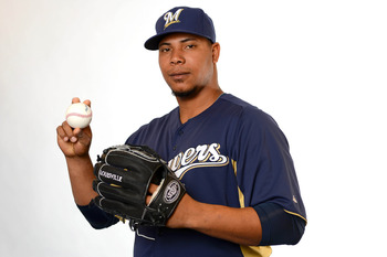 Feb 17, 2013; Maryvale, AZ, USA; Milwaukee Brewers relief pitcher Wily Peralta (60) poses for a picture during photo day at Maryvale Baseball Park. Mandatory Credit: Jake Roth-USA TODAY Sports