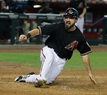 PHOENIX, AZ - SEPTEMBER 29:  Adam Eaton #6 of the Arizona Diamondbacks slides across home plate while scoring against the Chicago Cubs on an RBI single by Aaron Hill during the second inning of a MLB game at Chase Field on September 29, 2012 in Phoenix, A