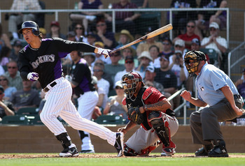SCOTTSDALE, AZ - MARCH 05:  Nolan Arenado #28 of the Colorado Rockies hits a RBI single against the Arizona Diamondbacks during the second inning of the spring training game at Salt River Fields at Talking Stick on March 5, 2012 in Scottsdale, Arizona.  (