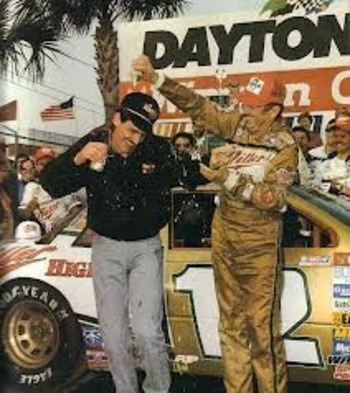 Bobby Allison and son Davey celebrate in victory lane after the 1988 Daytona 500 (Photo courtesy LegendsofNASCAR.com).