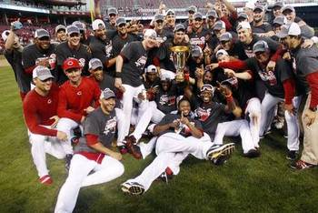 The Cincinnati Reds celebrate their 2013 NL Central title (Photo Credit: http://usatoday30.usatoday.com/sports/mlb/story/2012/09/22/minus-baker-reds-blank-dodgers-clinch-nl-central/57827484/1)