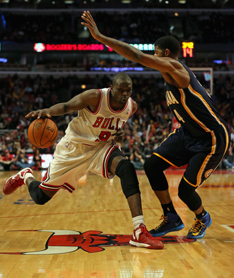 Paul George (right) guards Luol Deng
