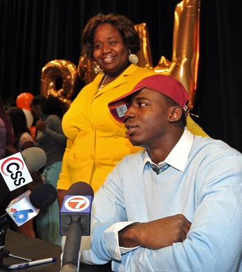 Feb 6, 2013; Miami, FL, USA; Booker T. Washington offense linebacker Matthew Thomas stands next to his mother Mariska Nyon and announces that he will attend Florida State on National Signing Day at Booker T. Washington Senior High. Mandatory Credit: Steve