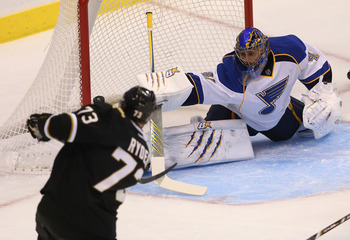 Jaroslav Halak (right) of the St. Louis Blues against Michael Ryder of the Dallas Stars.