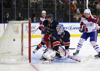 Montreal Canadien Alex Galchenyuk (right) scores against the New York Rangers.