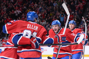 Lars Eller and teammates celebrate a goal.