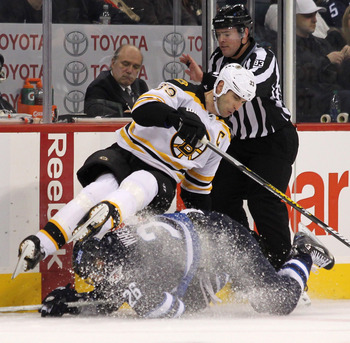 Captain Zdeno Chara leads a bruising Bruins defense.