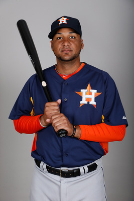 KISSIMMEE, FL - FEBRUARY 21:  Catcher Carlos Corporan #22 of the Houston Astros poses for a photo during photo day at Osceola County Stadium  on February 21, 2013 in Kissimmee, Florida.  (Photo by J. Meric/Getty Images)