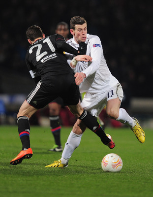 Maxime Gonalons stops Gareth Bale in his tracks.