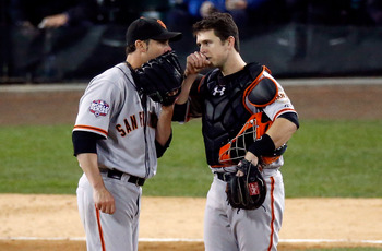 Vogelsong and Posey strategize against an opposing hitter.