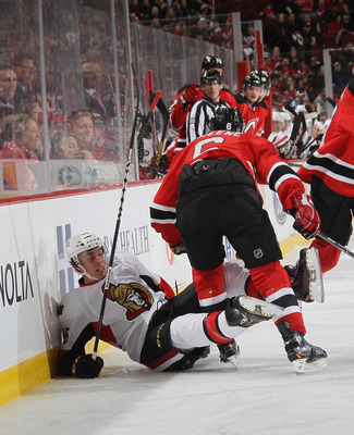 Andy Greene lays a clinical hip check in Monday's shoot out loss the the Sens