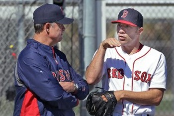 Manager John Farrell talks to Alfredo Aceves following a disappointing first drill. Photo via ESPN.com