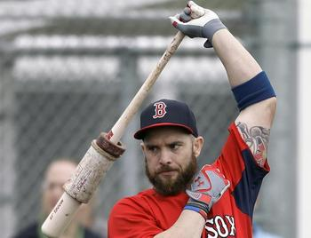 Jonny Gomes is being counted on to bring chemistry back to the Red Sox. Image via Boston.com.