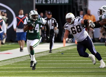 Oct 23, 2011; East Rutherford, NJ, USA; New York Jets cornerback Darrelle Revis (24) returns an interception during the game against the San Diego Chargers at Met Life Stadium.  Mandatory Credit: William Perlman/THE STAR-LEDGER via USA TODAY Sports