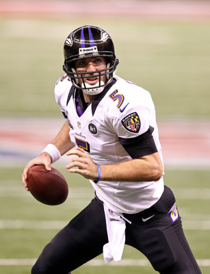 Feb 3, 2013; New Orleans, LA, USA; Baltimore Ravens quarterback Joe Flacco (5) looks to make a throw against the San Francisco 49ers during Super Bowl XLVII at the Mercedes-Benz Superdome. Mandatory Credit: Chuck Cook-USA TODAY Sports