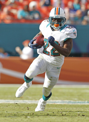MIAMI GARDENS, FL - DECEMBER 23: Reggie Bush #22 of the Miami Dolphins runs with the ball against the Buffalo Bills on December 23, 2012 at Sun Life Stadium in Miami Gardens, Florida. The Dolphins defeated the Bills 24-10. (Photo by Joel Auerbach/Getty Im