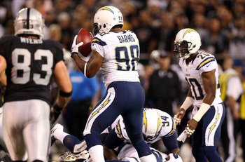 OAKLAND, CA - SEPTEMBER 10: Antwan Barnes #98 of the San Diego Chargers recovers a fumble in the first quarter of their game against the Oakland Raiders  during their season opener at Oakland-Alameda County Coliseum on September 10, 2012 in Oakland, Calif