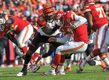 KANSAS CITY, MO - NOVEMBER 18:  Defensive end Carlos Dunlap #96 of the Cincinnati Bengals sacks quarterback Matt Cassel #7 of the Kansas City Chiefs during the first half on November 18, 2012 at Arrowhead Stadium in Kansas City, Missouri.  (Photo by Peter