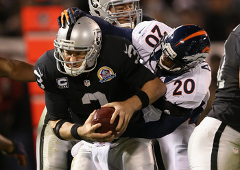 OAKLAND, CA - DECEMBER 06: Mike Adams #20 of the Denver Broncos sacks Carson Palmer #3 of the Oakland Raiders at O.co Coliseum on December 6, 2012 in Oakland, California.  (Photo by Ezra Shaw/Getty Images)