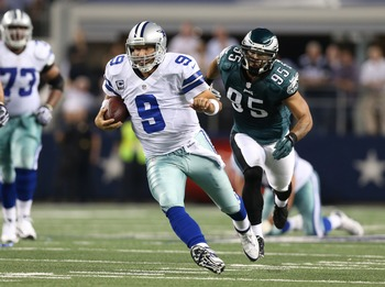 Dec 2, 2012; Arlington, TX, USA; Dallas Cowboys quarterback Tony Romo (9) scrambles against the Philadelphia Eagles at Cowboys Stadium. Mandatory Credit: Matthew Emmons-USA TODAY Sports