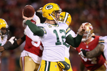 SAN FRANCISCO, CA - JANUARY 12:  Quarterback Aaron Rodgers #12 of the Green Bay Packers throws the ball against the San Francisco 49ers in the first quarter during the NFC Divisional Playoff Game at Candlestick Park on January 12, 2013 in San Francisco, C