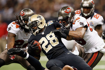 NEW ORLEANS, LA - DECEMBER 16:   Mark Ingram #28 of the New Orleans Saints is tackled by  Mark Barron #24 of the Tampa Bay Buccaneers at the Mercedes-Benz Superdome on December 16, 2012 in New Orleans, Louisiana.  (Photo by Chris Graythen/Getty Images)