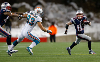 FOXBORO, MA - DECEMBER 30: Wes Welker #83 of the New England Patriots runs with the ball after catching a pass in front of Jason Trusnik #93 of the Miami Dolphins during the game at Gillette Stadium on December 30, 2012 in Foxboro, Massachusetts. (Photo b