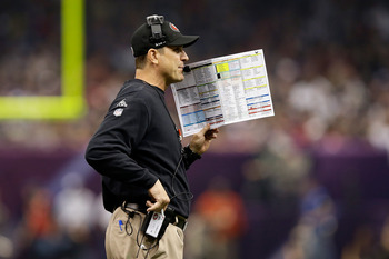 NEW ORLEANS, LA - FEBRUARY 03:  Head coach Jim Harbaugh of the San Francisco 49ers coaches against the Baltimore Ravens during Super Bowl XLVII at the Mercedes-Benz Superdome on February 3, 2013 in New Orleans, Louisiana.  (Photo by Ezra Shaw/Getty Images