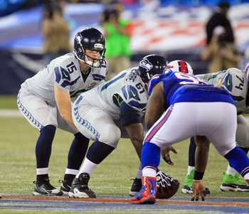 Dec 16, 2012; Toronto, Ontario, Canada; Seattle Seahawks quarterback Matt Flynn (15) under center against the Buffalo Bills during the second half at the Rogers Centre. Seahawks beat the Bills 50-17. Mandatory Credit: Kevin Hoffman-USA TODAY Sports