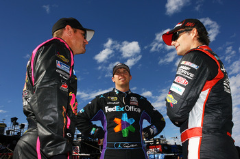 No, Denny Hamlin (center) is not refereeing a fight between Clint Bowyer (left) and Jeff Gordon.