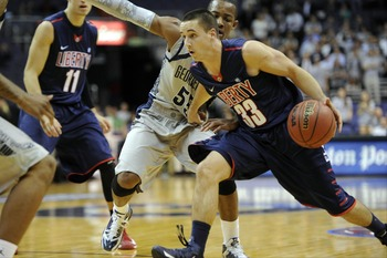 John Caleb Sanders posted 24 points, seven rebounds and 10 assists in Liberty's 102-101 loss at Longwood.