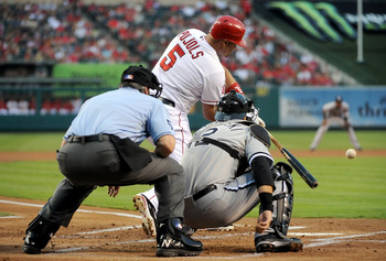 Angels first baseman Albert Pujols drives a ball against the Chicago White Sox, Sept. 22.