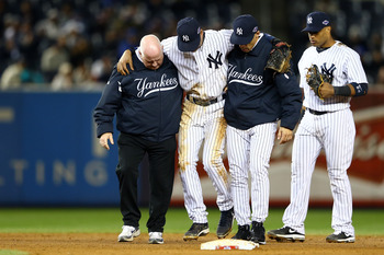 Derek Jeter is helped off the field after breaking his ankle against Detroit in Game 1 of the ALCS, Oct. 13.
