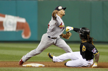 Cardinals shortstop Rafael Furcal attempts to turn a double play against Pittsburgh, Aug. 27.