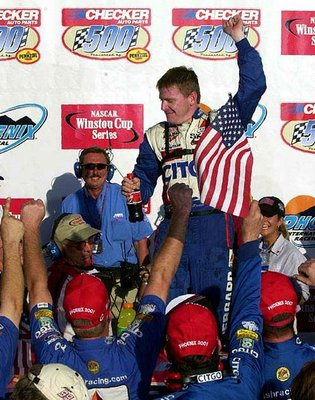 Burton celebrates the second of his two Phoenix wins in 2001. (AP Photo)