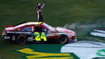 Jeff Gordon rolled to Victory Lane in a slightly clobbered Hendrick Chevy at Phoenix in 2011. (Photo: Getty Images)