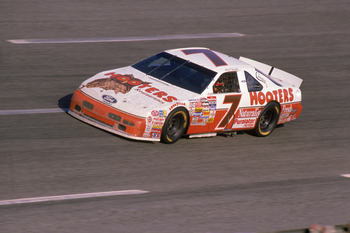 Alan Kulwicki won the inaugural Phoenix race, introducing his patented Polish Victory Lap afterward.
