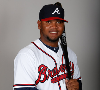 LAKE BUENA VISTA, FL - FEBRUARY 20:  Infielder Juan Francisco #25 of the Atlanta Braves poses for a photo during photo day at Champion Stadium at the ESPN Wide World of Sports Complex at Walt Disney World on February 20, 2013 in Lake Buena Vista, Florida.