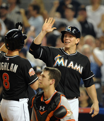 Chris Coghlan, left, and Logan Morrison, right, celebrate last season in a game against the San Francisco Giants. The pair will have to prove they can stay healthy and be productive in 2013.
