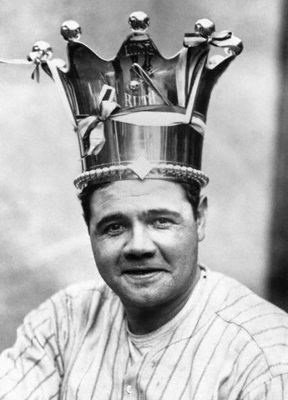 Babe Ruth showing off his hot-dog eating crown.