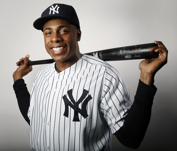 Curtis Granderson poses during New York Yankee Photo Day on February 20, 2013